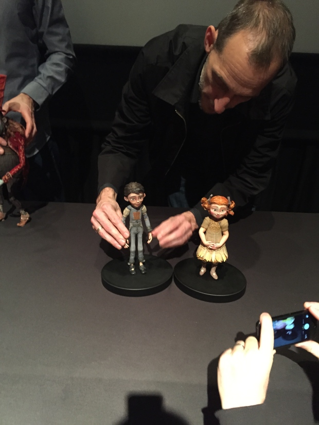 Director Stacchi demonstrates the flexibility of the dolls as he stages them